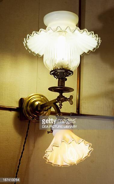 Dual wall lamp one using gas with Auer spout and the other electricity ca 1895 France 19th century