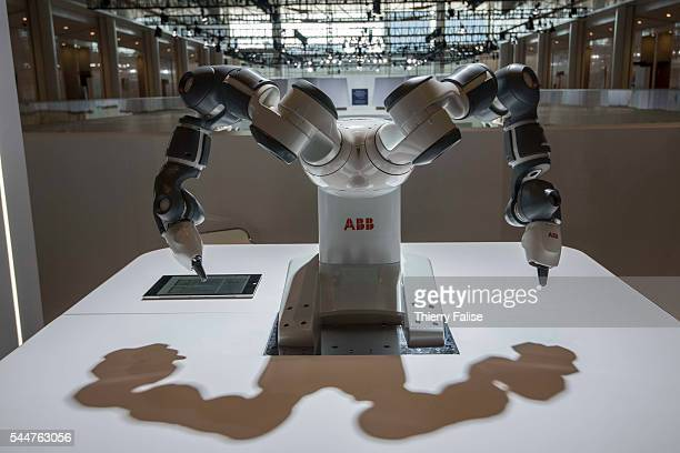A dualarm robot capable of collaborating with humans in industrial tasks and designed by the SwedishSwiss engineering company ABB is exhibited at the...