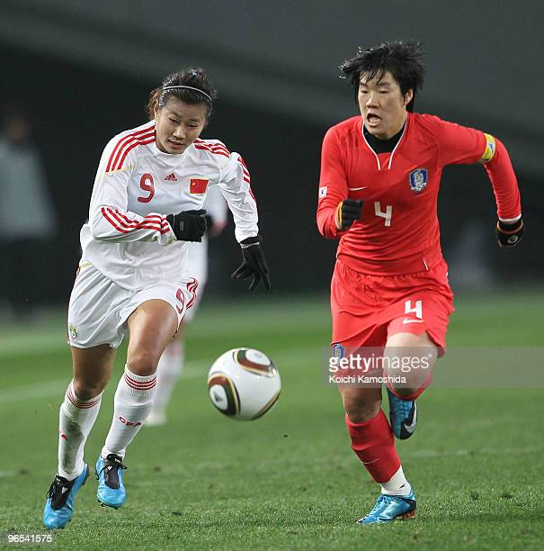 Duan Han of China and Yoo Mi Kim of South Korea compete for the ball during the East Asian Football Federation Women's Championship 2010 match...