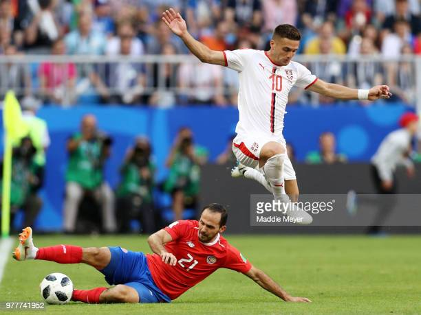 June 17: Duan Tadi of Serbia leaps over a tackle from Marco Ureña of Costa Rica during the 2018 FIFA World Cup Russia group E match between Costa...