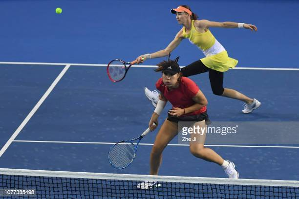 Duan Yingying of China and Renata Voracova of the Czech Republic return a shot against Shuai Peng and Zhaoxuan Yang of China during their women's...