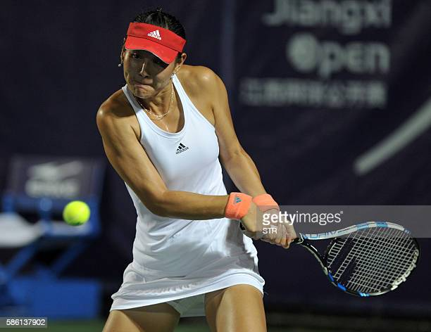 Duan Yingying of China hits a return against Kurumi Nara of Japan during their singles quarterfinal match at the Jiangxi Open WTA tennis tournament...