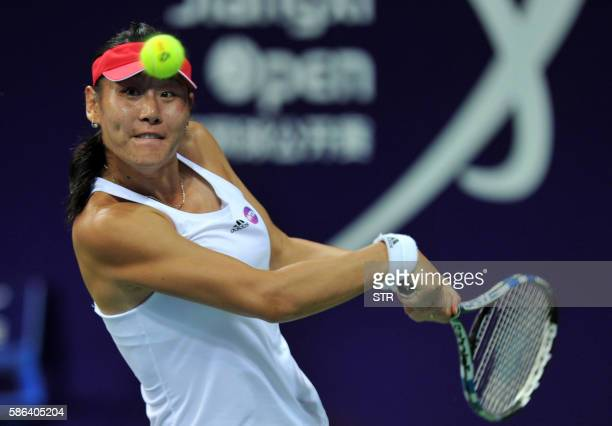 Duan Yingying of China hits a return against Misa Eguchi of Japan during their singles semifinal match at the Jiangxi Open WTA tennis tournament in...