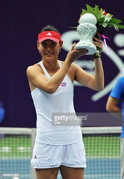 Duan Yingying of China poses with her trophy after winning the singles final match against Vania King of the US at the Jiangxi Open WTA tennis...