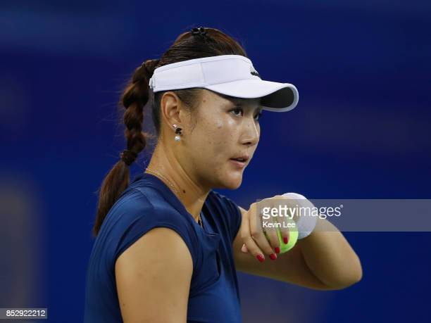 Duan Yingying of China reacts during a match against Elena Vesnina of Russia in first round on Day 1 of 2017 Wuhan Open on September 24 2017 in Wuhan...