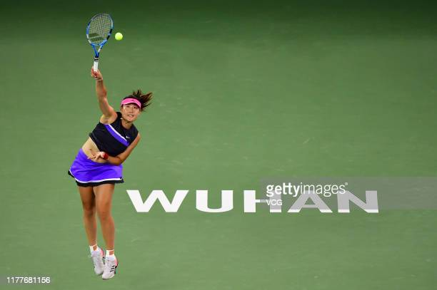 Duan Yingying of China severs in the doubles final match against Elise Mertens of Belgium and Aryna Sabalenka of Belarus on Day seven of 2019...