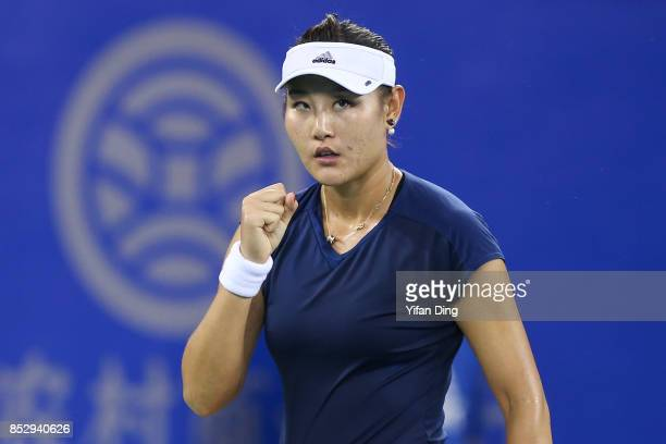 Duan Yingying reacts during the match against Elena Vesnina on Day 1 of 2017 Dongfeng Motor Wuhan Open at Optics Valley International Tennis Center...