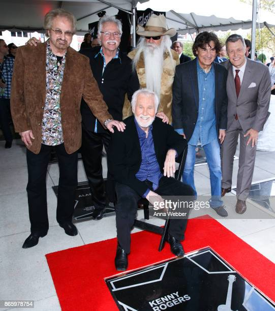 Duane Allen Joe Bonsall William Lee Golden and Richard Sterban of the Oak Ridge Boys pose with Kenny Rogers attend as Kenny Rogers is inducted into...