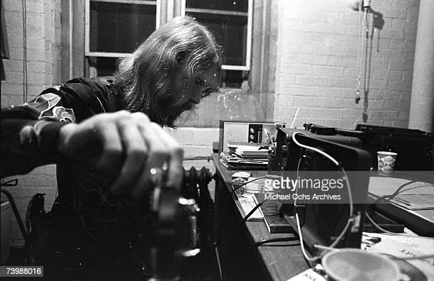 Duane Allman tunes up backstage before the Allman Brothers' performance at the Sitar on October 17 1970 in Spartanburg South Carolina