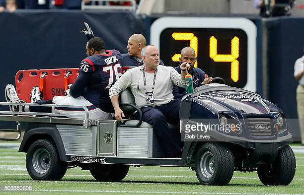 Duane Brown of the Houston Texans is carted off the field after sustaing a torn quadracep muscle against the Jacksonville Jaguars at NRG Stadium on...