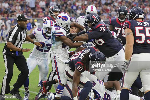 Duane Brown of the Houston Texans pushes Leodis McKelvin of the Buffalo Bills after the play in the second quarter in a NFL game on September 28,...