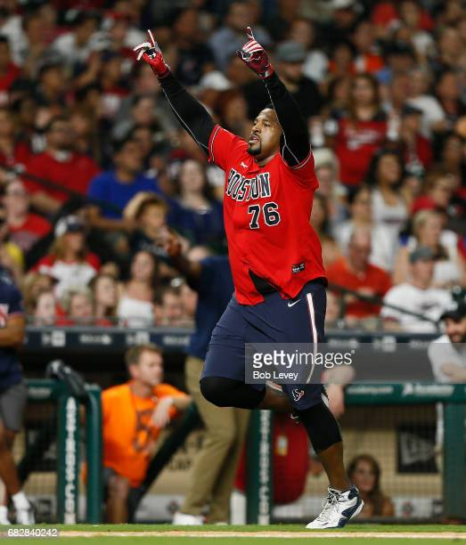 Duane Brown of the Houston Texans scores during the JJ Watt Charity Softball Game at Minute Maid Park on May 13, 2017 in Houston, Texas.