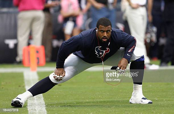Duane Brown of the Houston Texans stretches before playing the St. Louis Rams at Reliant Stadium on October 13, 2013 in Houston, Texas.