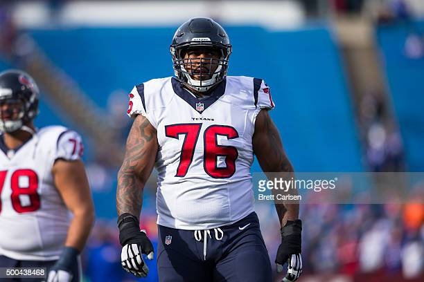 Duane Brown of the Houston Texans warms up with teammates before the game against the Buffalo Bills on December 6, 2015 at Ralph Wilson Stadium in...