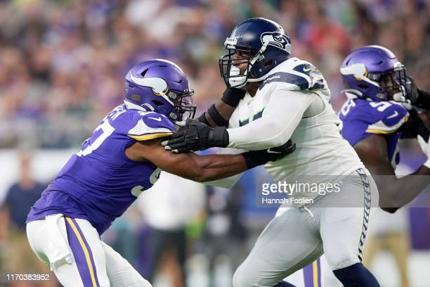 Duane Brown of the Seattle Seahawks blocks Everson Griffen of the Minnesota Vikings during the preseason game at U.S. Bank Stadium on August 18, 2019...