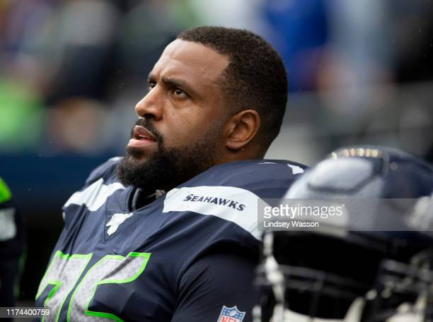 Duane Brown of the Seattle Seahawks sits on the bench in the third quarter against the Cincinnati Bengals at CenturyLink Field on September 8, 2019...