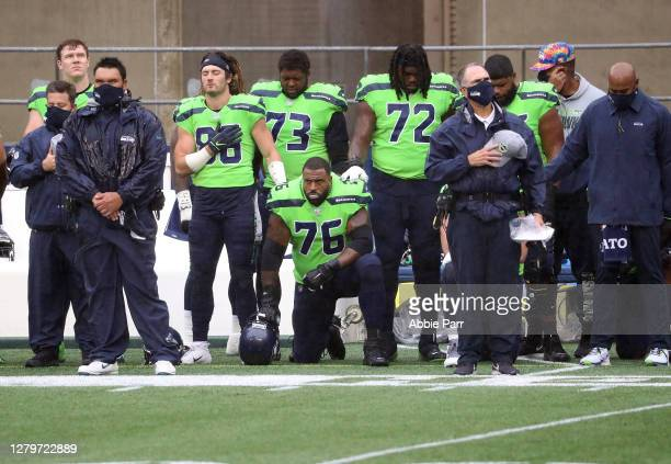 Duane Brown of the Seattle Seahawks takes a knee during the national anthem before the start of a game against the Minnesota Vikings at CenturyLink...