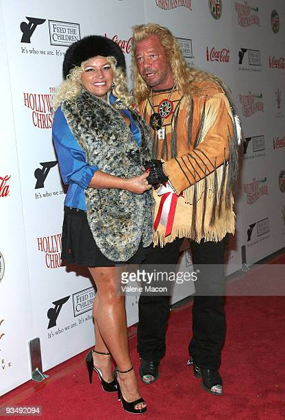 """Duane """"Dog"""" Chapman and wife Beth Smith Chapman attend the 2009 Hollywood Christmas Parade on November 29, 2009 in Hollywood, California."""