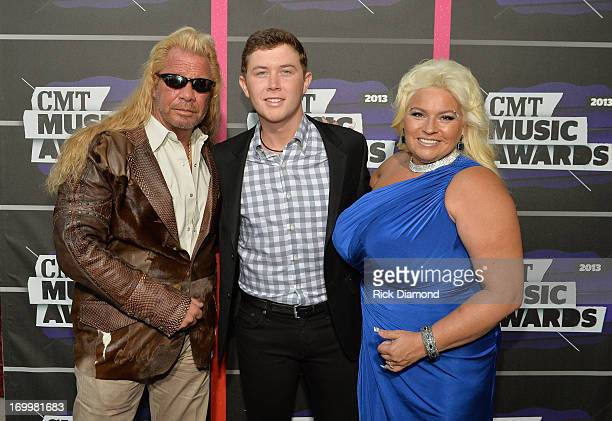 Duane Dog Lee Chapman, Scotty McCreery, and Beth Chapman attends the 2013 CMT Music awards at the Bridgestone Arena on June 5, 2013 in Nashville,...