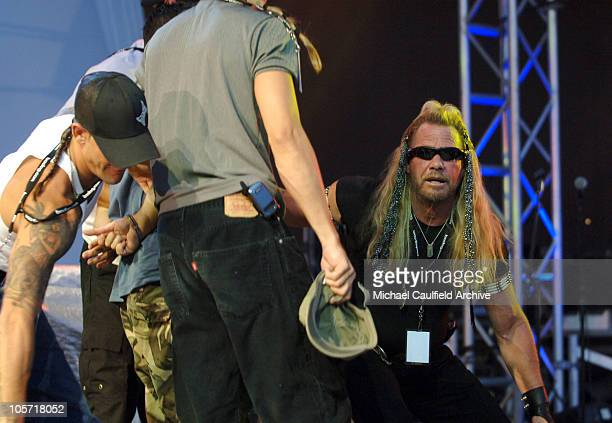 Duane Dog the Bounty Hunter Chapman and his men tackle an autographseeking fan who got on stage