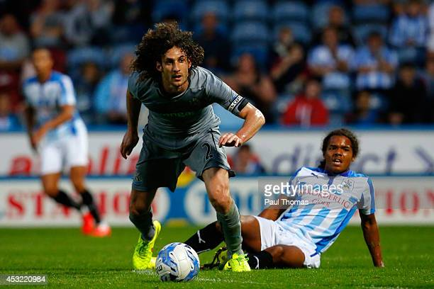 Duane Holmes of Huddersfield in action with Fabricio Coloccini of Newcastle during the Pre Season Friendly match between Huddersfield Town and...