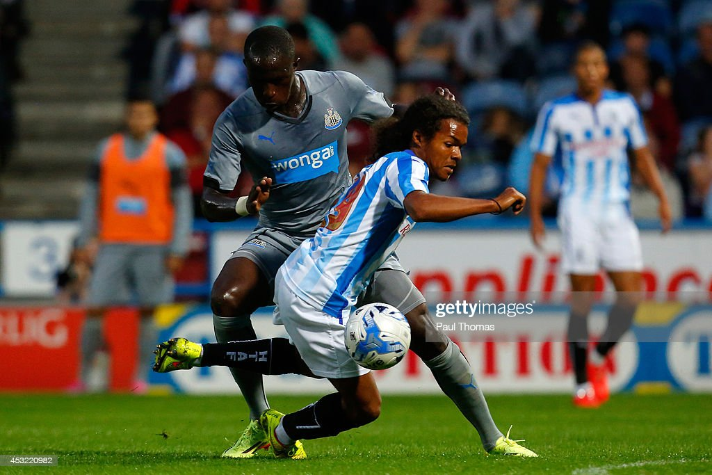 Duane Holmes of Huddersfield in action with Moussa Sissoko (L) of Newcastle during the Pre Season Friendly match between Huddersfield Town and Newcastle United at the John Smith's Stadium on August 5, 2014 in Huddersfield, England.