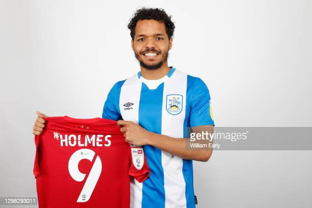 Duane Holmes signs for Huddersfield Town from Derby County at PPG Canalside on January 25, 2021 in Huddersfield, England.