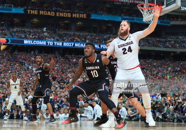 Duane Notice of the South Carolina Gamecocks and Przemek Karnowski of the Gonzaga Bulldogs battle for position during the 2017 NCAA Men's Final Four...