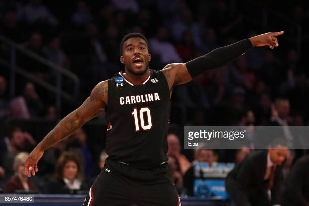 Duane Notice of the South Carolina Gamecocks celebrates a three point basket in the first half against the Baylor Bears during the 2017 NCAA Men's...