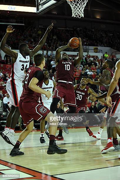 Duane Notice of the South Carolina Gamecocks drives the lane during the South Carolina Gamecocks' basketball game against the Georgia Bulldogs at...