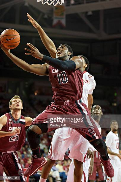 Duane Notice of the South Carolina Gamecocks goes up for a layup against the Arkansas Razorbacks at Bud Walton Arena on February 19, 2014 in...