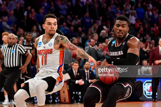 Duane Notice of the South Carolina Gamecocks is defended by Chris Chiozza of the Florida Gators during the second half of the 2017 NCAA Men's...