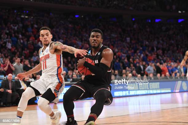 Duane Notice of the South Carolina Gamecocks is guarded by Chris Chiozza of the Florida Gators during the 2017 NCAA Photos via Getty Images Men's...