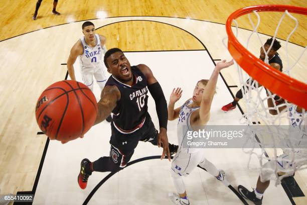 Duane Notice of the South Carolina Gamecocks shoots the ball against Luke Kennard of the Duke Blue Devils in the second half during the second round...