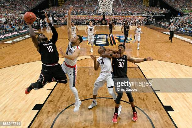 Duane Notice of the South Carolina Gamecocks takes a jumpshot over Nigel WilliamsGoss of the Gonzaga Bulldogs during the 2017 NCAA Men's Final Four...