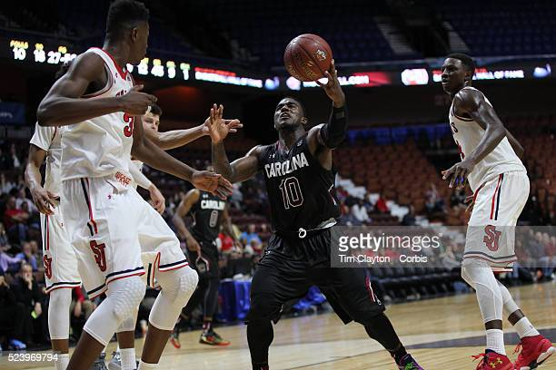 Duane Notice South Carolina shows great determination as he fights for a loose ball with Yankuba Sima and Kassoum Yakwe St John's during the St...