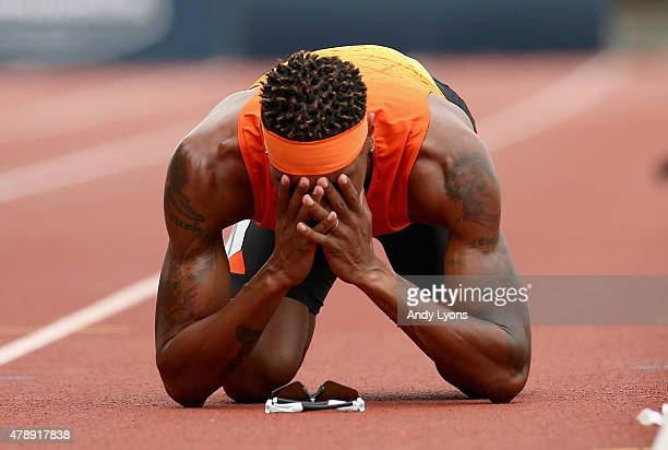 Duane Solomon Jr kneels on the track after falling just short of the finish line in the Mens 800 Meter during day four of the 2015 USA Outdoor Track...