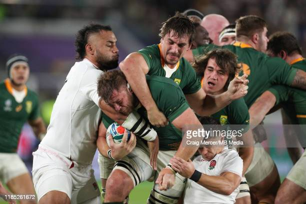 Duane Vermeulen of South Africa driven forward by team mate Eben Etzebeth under pressure from Billy Vunipola and Ben Youngs of England during the...