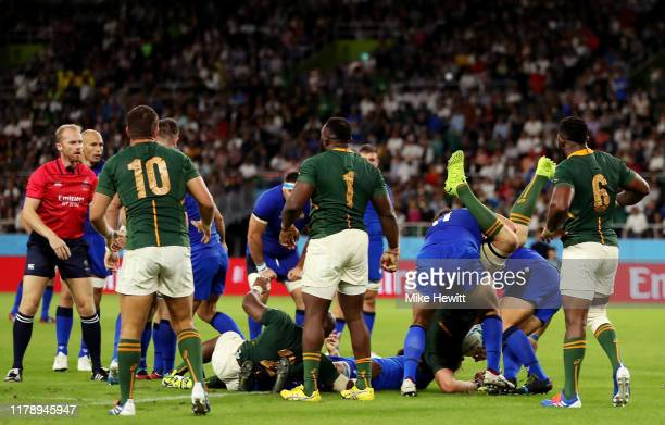 Duane Vermeulen of South Africa is fouled by Andrea Lovotti of Italy resulting in Andrea Lovotti of Italy receiving a red card during the Rugby World...