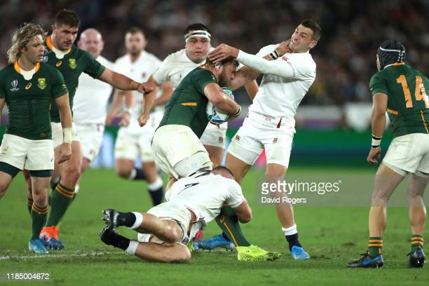 Duane Vermeulen of South Africa is tackled by Jonny May and Sam Underhill of England during the Rugby World Cup 2019 Final between England and South...