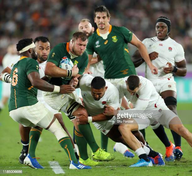 Duane Vermeulen of South Africa is tackled by Manu Tuilagi of England during the Rugby World Cup 2019 Final between England and South Africa at...