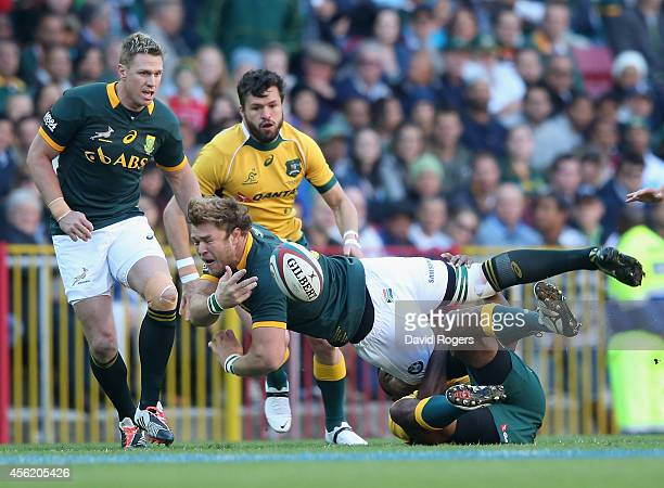Duane Vermeulen of South Africa off loads the ball during The Rugby Championship match between the South African Springboks and the Australian...