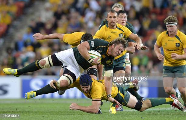Duane Vermeulen of the Springboks is tackled during The Rugby Championship match between the Australian Wallabies and the South African Springboks at...