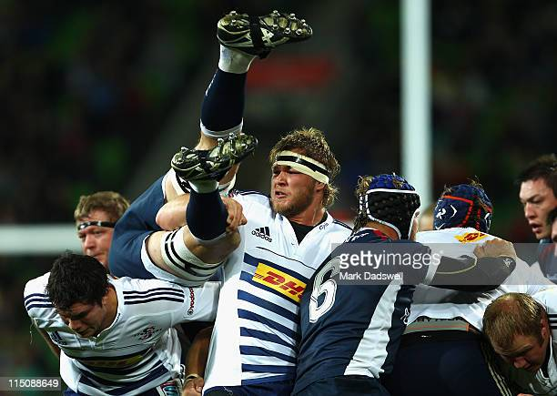 Duane Vermeulen of the Stormers brushes off Kevin O'Neill of the Rebels during the round 16 Super Rugby match between the Rebels and the Stormers at...