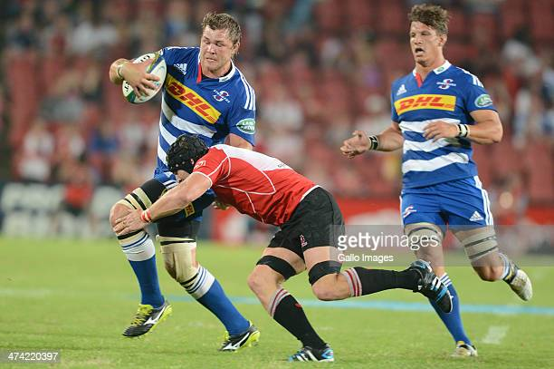 Duane Vermeulen of the Stormers tackled by Jaco Kriel of the Lions during the Super Rugby match between Lions and DHL Stormers at Ellis Park on...