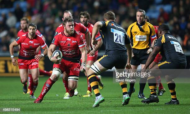 Duane Vermeulen of Toulon runs with the ball during the European Rugby Champions Cup match between Wasps and Toulon at the Ricoh Arena on November 22...
