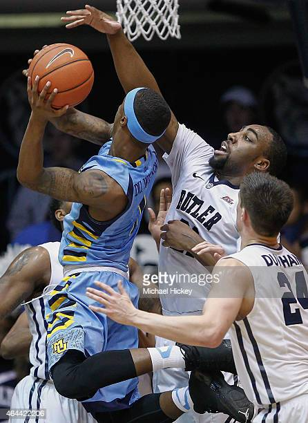 Duane Wilson of the Marquette Golden Eagles attempts to shoot the ball as Roosevelt Jones of the Butler Bulldogs goes for the block at Hinkle...