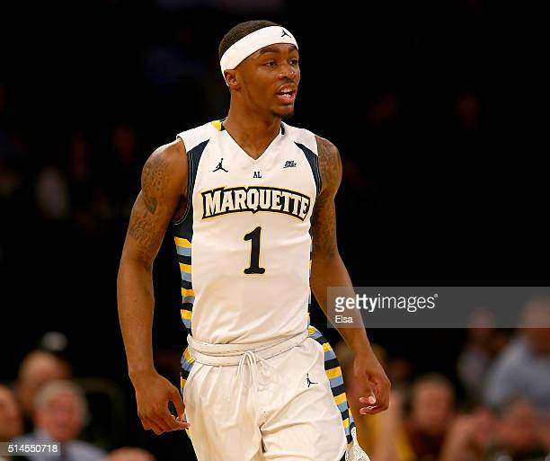 Duane Wilson of the Marquette Golden Eagles celebrates his three point shot in the first half against the St John's Red Storm during the Big East...