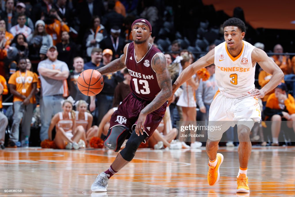 Duane Wilson #13 of the Texas A&M Aggies dribbles up court against James Daniel III #3 of the Tennessee Volunteers in the second half of a game at Thompson-Boling Arena on January 13, 2018 in Knoxville, Tennessee. Tennessee won 75-62.