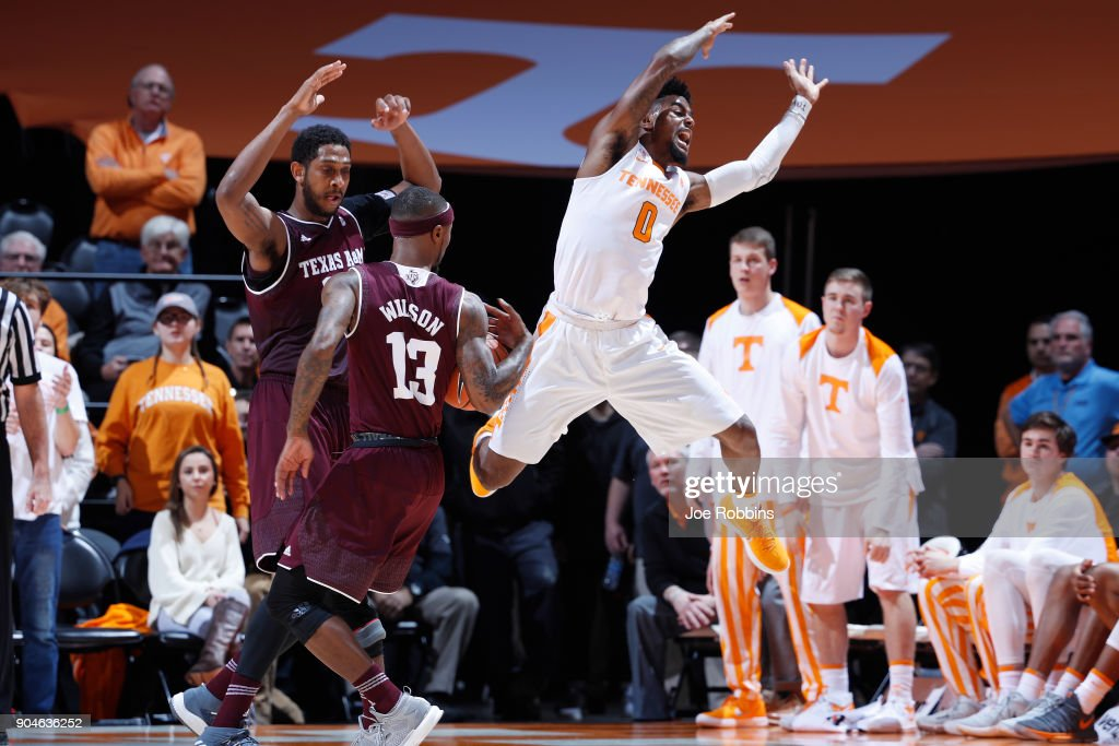 Duane Wilson #13 of the Texas A&M Aggies strips the ball away from Jordan Bone #0 of the Tennessee Volunteers in the second half of a game at Thompson-Boling Arena on January 13, 2018 in Knoxville, Tennessee. Tennessee won 75-62.